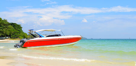Beautiful beach with red motor boat at Samed island, Thailand