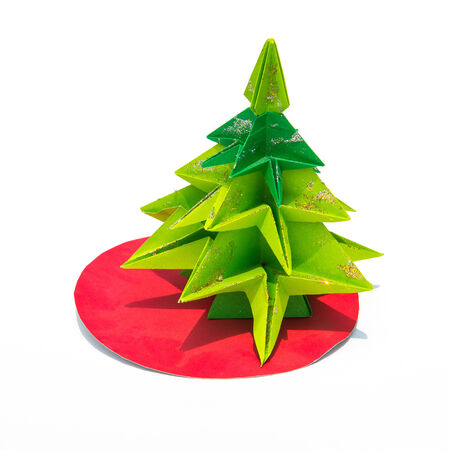 Green origami christmas tree isolated on white background