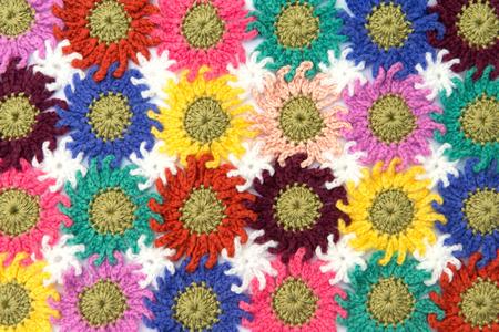 Crochet fabric flowers pattern in white background. Homemade. photo