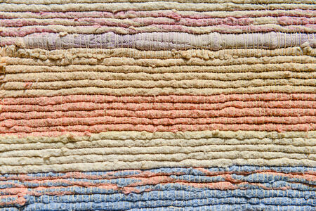 Multicolor fabric texture. Handmade traditional Thailand carpet. photo