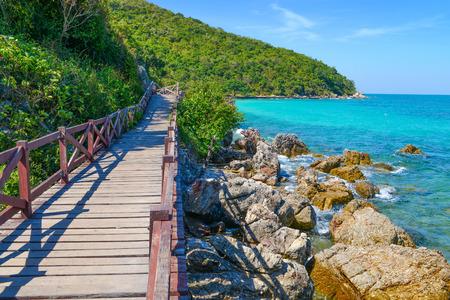 Jetty to a tropical beach on island, at koh lan island Pattaya city Chonburi Thailand. Banco de Imagens