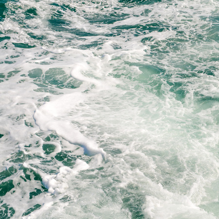astern: The wake of a boat as seen from the stern of a ship.