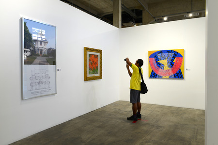 BANGKOK - JANUARY 16: Visitors are shooting the arts in Contemporary Art Exhibition by Kamol Tassananchalee & Friends 71 years anniversary on January 16, 2015 at Ratchadamnoen Contemporary Art Center in Bangkok, Thailand.