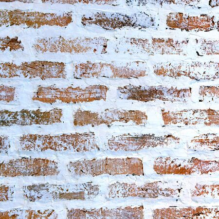 White paint on the brick wall for background and texture photo
