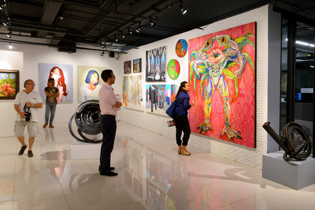 BANGKOK - NOVEMBER 28: People look at painting and sculpture during Thai Contemporary Art Exhibition on November 28, 2014 at Hof Art Gallery, Bangkok, Thailand.
