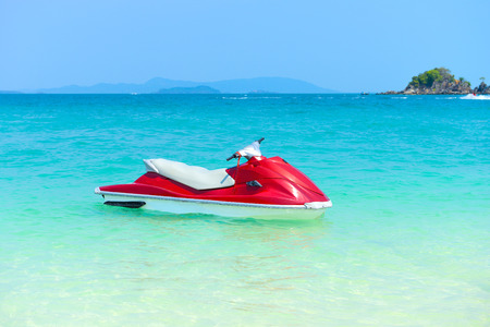 power boat: Red Jet ski on the beach of Andaman Sea in summer vacation at Khai Nok island Phang Nga, Thailand.
