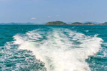 astern: The wake of a boat as seen from the stern of a ship of Andaman sea at Phuket, Thailand
