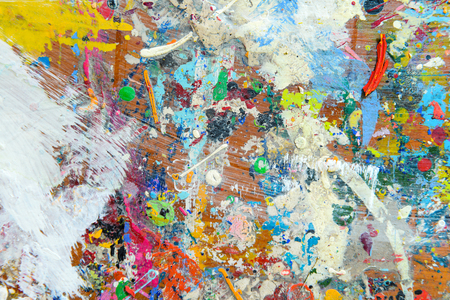 fineart: Abstract colorful texture background. Splash acrylic color on wood table.