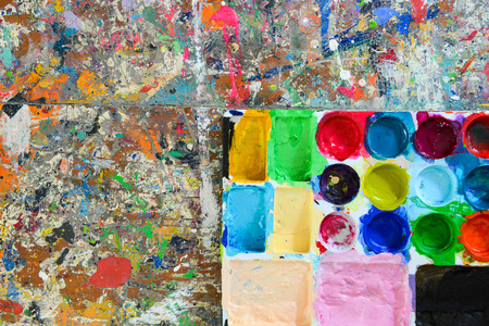 fineart: Colorful palette and Splash acrylic color on wood table. Abstract, Texture, Background.