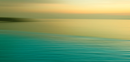 water panoramic: Blurred background of refraction in water. Panoramic dramatic view of Infinity Swimming Pool with sunset on the sea at twilight times.