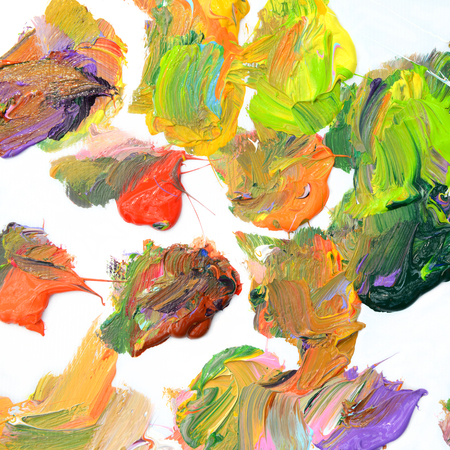 Colorful oil paint of different colors on a palette on white background Stock Photo