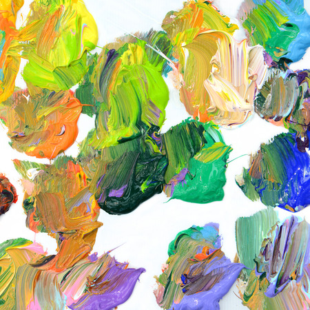 Colorful oil paint of different colors on a palette on white background Stock fotó