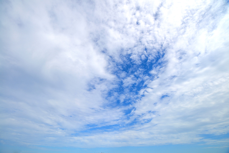 The blue sky and motion white fluffy clouds Stock Photo