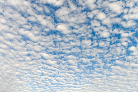 The blue sky and white fluffy clouds