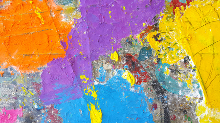 Abstract colorful painting for texture background. Splash acrylic color on wood table.