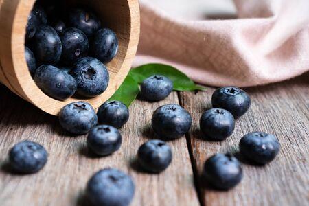 Freshly blueberries in wooden bucket Stock Photo