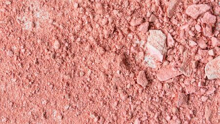 Smear of crushed orange blush on as sample of cosmetics product, macro, copy space, top view