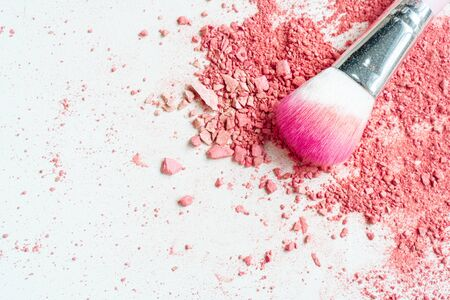 Smear of crushed pink blush on as sample of cosmetics product and brush, copy space, top view Stock fotó