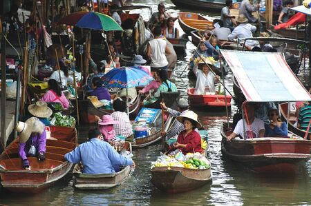 ferrying: boats busy ferrying people at Amphawa floating market on April 13, 2011 in Bangkok  A traditional popular method of buying and selling still practiced in Amphawa canals of Thailand