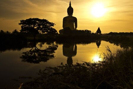 silhouette Golden Buddhas at Wat Muang, Ang Thong Province, thailand photo