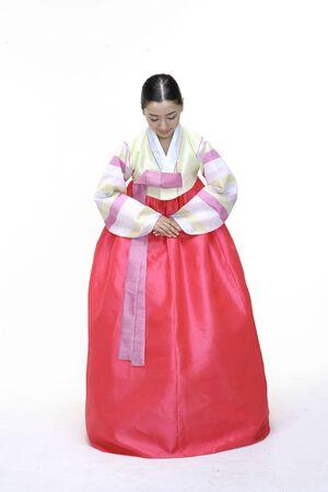 head bowed: Couple in Korean Dress