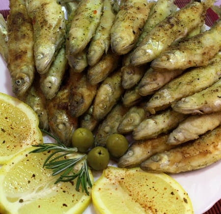 It is freshly caught and fried smelts photo