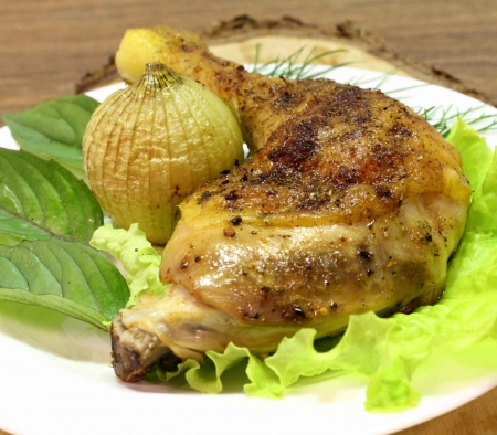 fried chicken quarter with the fried onions, basil and lettuce leaves photo