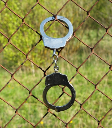 lock in handcuffs to the fence symbolizes captivity Stock Photo - 14271287