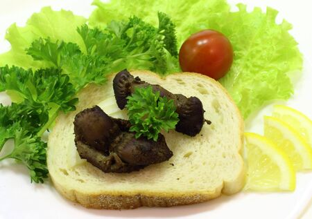 giblets: it is smoked vista gizzard appetizer with vegetables and lemon