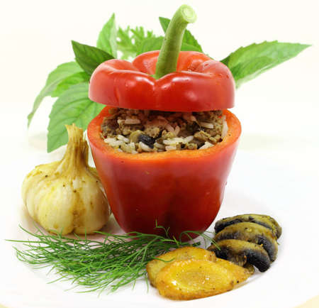 stuffed pepper with meat, rice and mushrooms photo