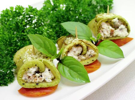 Zucchini roll with cottage cheese and herbs photo