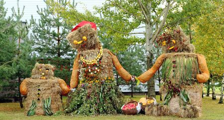 Autumn harvest decoration scarecrow family mother father and child photo