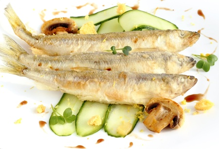 Freshly fried smelt served with cucumber strips