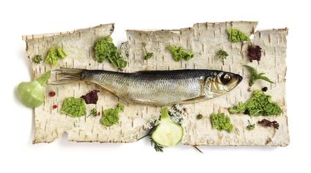 smoked herring on the dried birch bark photo