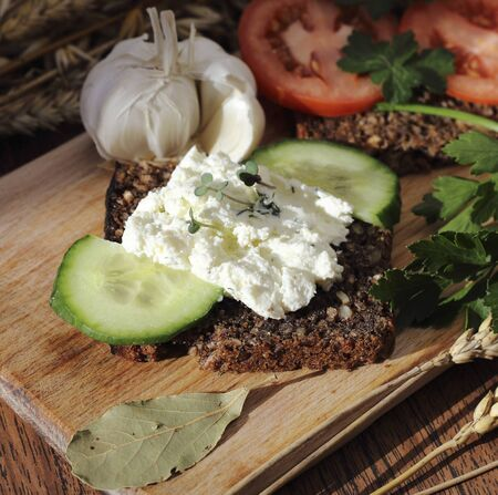 Cottage cheese sandwich with whole grain bread and vegetables photo