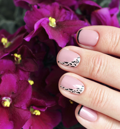 nicely: Close up shot of nicely manicured woman fingernails