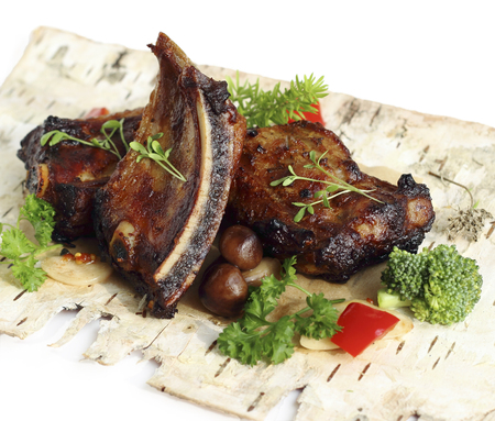 meat alternatives: Grilled pork ribs with mushrooms and herbs Stock Photo