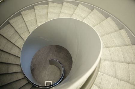 Look down a modern spiral Staircase in a Office Building photo