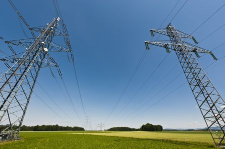 Power lines in a summer landscape with clear sky Stock Photo - 7274997