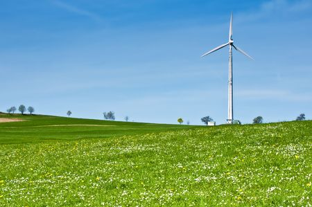 Wind Turbine in Spring Meadow full with Daisies Stock Photo - 7295490
