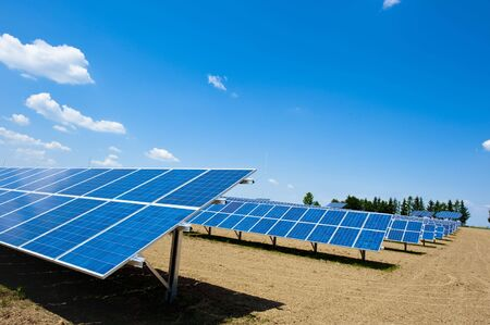 Solar Energy Farm with bright Sky and some Clouds photo