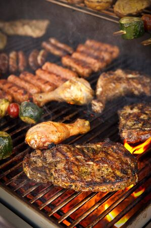 bbq background: Steak and other Meat on BBQ