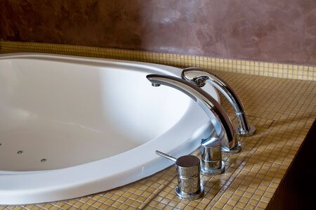 Detail of a Hotel Bathtub with chromed Faucet photo
