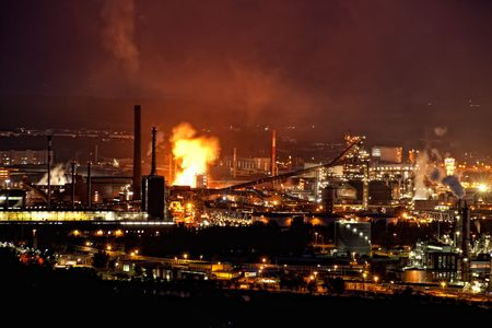 infernal: Industry at Night with infernal Fire Stock Photo