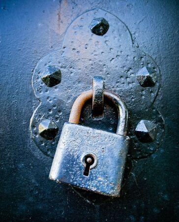 Rusty Lock on a wrought-iron Door photo