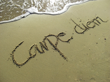 Carpe Diem written in the Sand with Wave