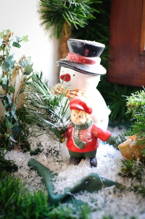 Antique Snowman on the Window Sill decorated with Fir Branch photo
