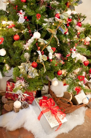 Rural Christmas Tree with some Presents under it Stock Photo - 8372327