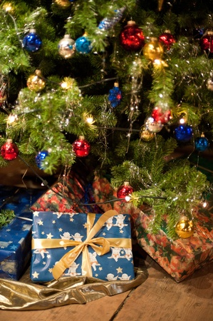 Christmas Presents under an antique decorated Christmas Tree Stock Photo - 8456586