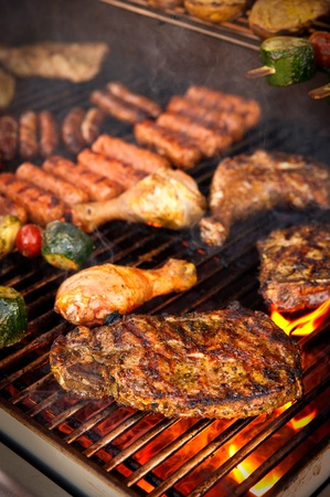 Steak and other Meat on a BBQ Stock Photo